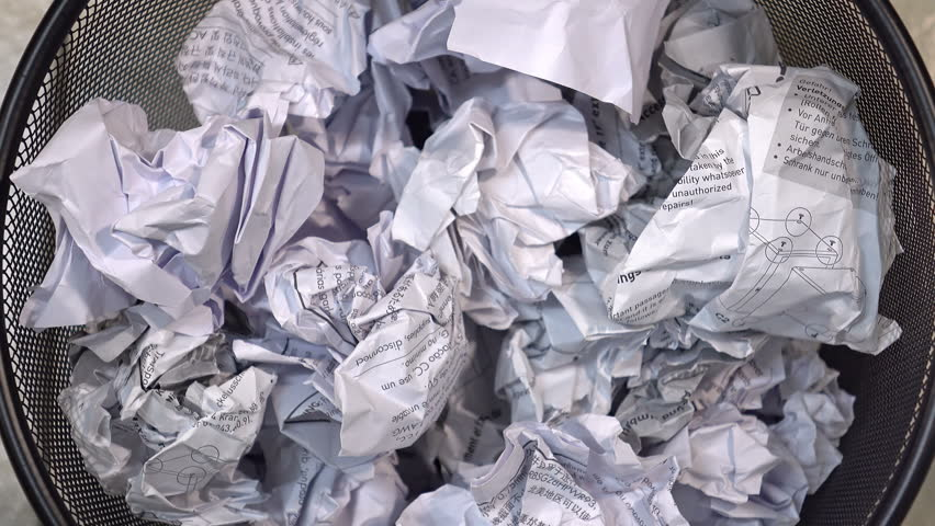 Throwing useless paper into the waste basket