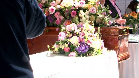 Coffin at funeral flowers at last goodbye ceremony