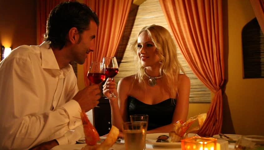 Couple having dinner in a fancy restaurant