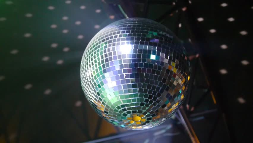 Rotating mirror disco ball in night club reflection of people on mirror ball rotates on ceiling in night club hd stock video clip aloadofball Image collections
