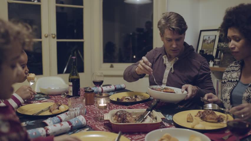 Mixed race family eating Christmas dinner   Shutterstock HD Video #16152550