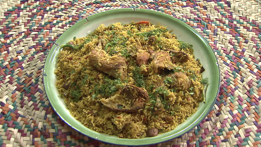 Stock video of arabic food cu zoom in shot on a steaming dish of arabic food cu top shot of a steaming dish of mandi made with mutton and forumfinder Gallery