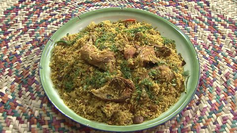 Arabic Food. CU top shot of a steaming dish of Mandi made with mutton and chicken, a traditional dish from Yemen but popular throughout the Gulf.