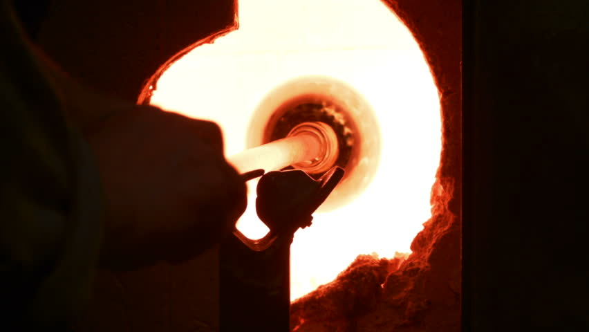 Blowing Glass - Heating the piece (flashing) in the glory hole