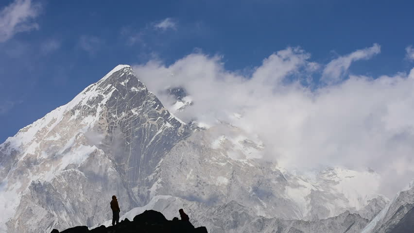 Hikers at mount Nuptse, Himalaya. Timelapse