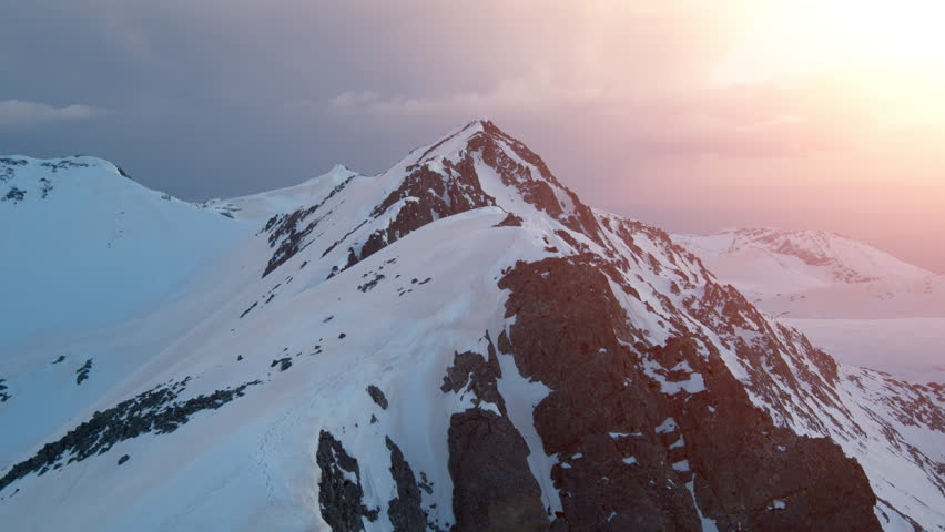 Epic Aerial Flight Over Mountain Peak Edge Range At Sunset Inspirational Winter Nature Landscape Concept