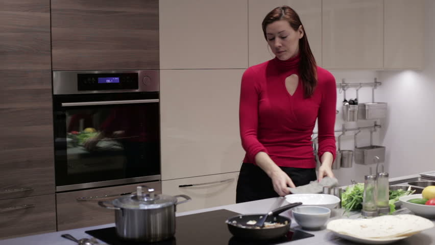 A Woman Pulls Out Dish From The Oven Hd Stock Fooe Clip