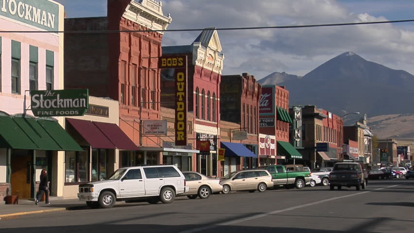 BIG TIMBER, MONTANA - CIRCA 2009: People walk along a street in a quaint Western town.