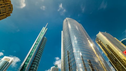 underside panoramic and perspective view to steel glass high rise building skyscrapers timelapse hyperlapse, Dubai, UAE