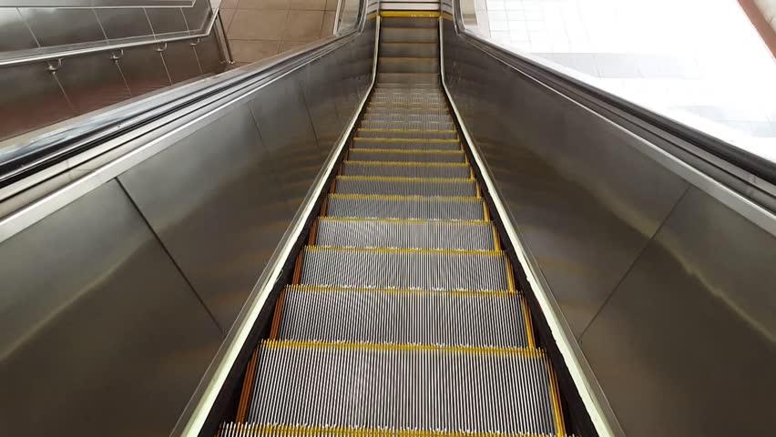 Beautiful Moving Down On Escalators   HD Stock Footage Clip