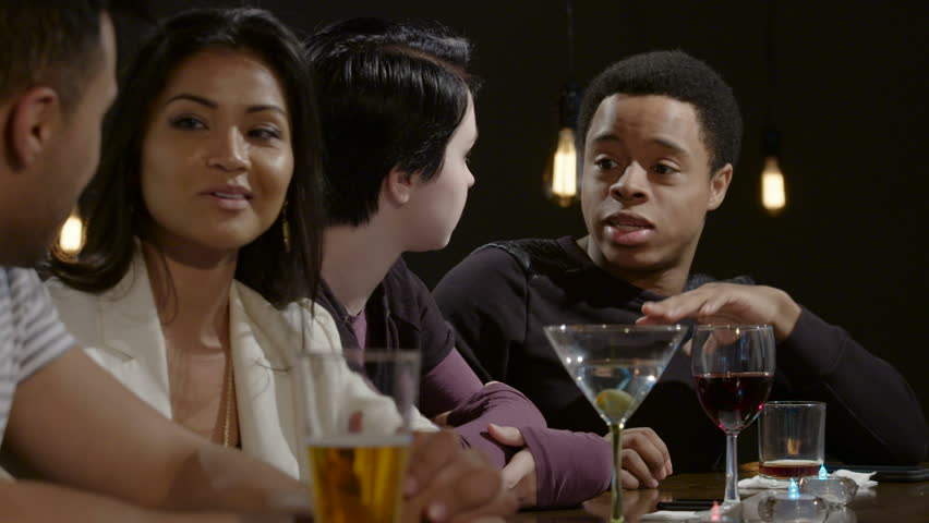 Young couples talking at a bar | Shutterstock HD Video #16330966