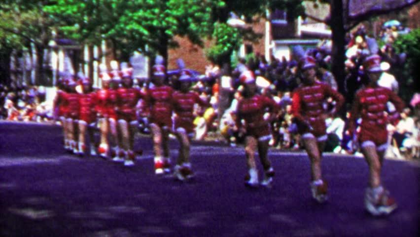 WINCHESTER, NEW YORK 1952: Marching band chorus line parade woman falls after high kick.
