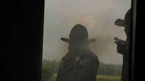 VIRGINIA - 2014. Re-enactment recreation of classic Old West, 1800s Western gunfight, and Killing. Cowboys and Outlaws. 1870-1890 western life. Guns and shootouts. OK Corral. Tombstone.  Shootout