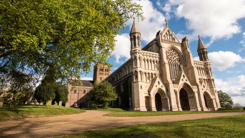ST. ALBANS, UK - 29 APRIL 2016: Time lapse video footage of the facade of St. Albans cathedral, a key landmark in the Hertfordshire. Clouds passing swiftly by place the building into sun and shade.