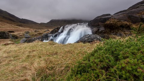 Waterfall in Autumn in Snowdonia National Park, Wales, United Kingdom - 4K Motion Timelapse