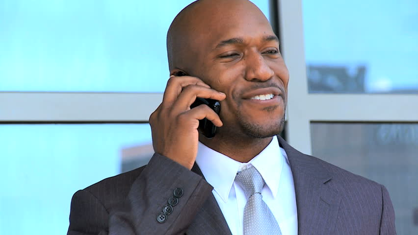 Ethnic Businessman in Close up Talking on Smartphone | Shutterstock HD Video #1637746