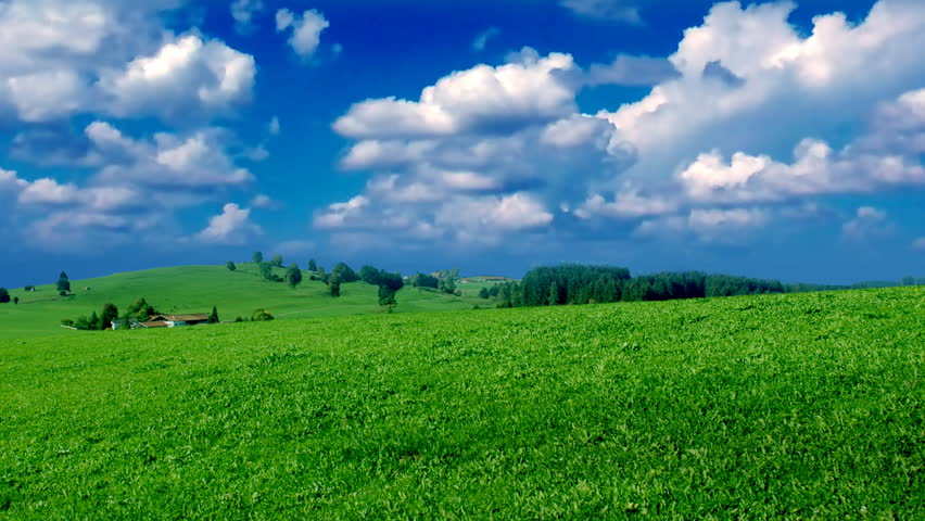 time lapse green field clouds