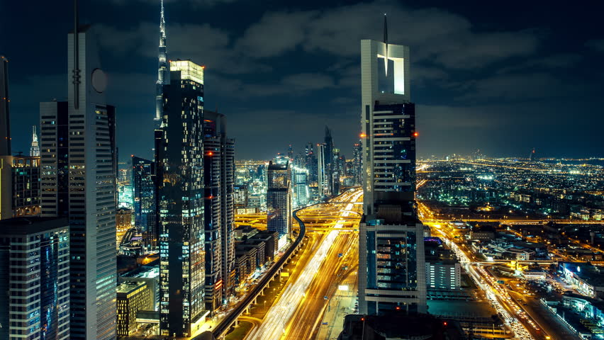 Sheikh Zayed road in Dubai, UAE, with fast moving traffic and skyscrapers. Nighttime timelapse. #16454476