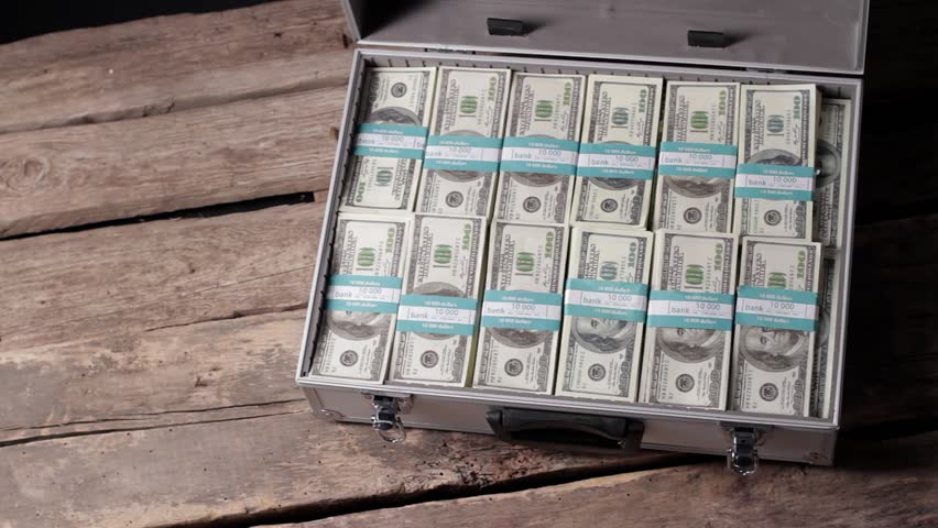 Hands opening case with dollars. Businessman opens suitcase with money. You have a good share. Money can buy everything.