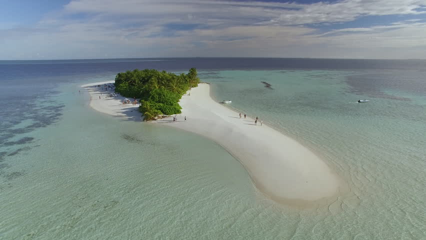 Flight over of a small tropical island in Maldives island, 2015. Palm trees on the sandbank.   Shutterstock HD Video #16501036