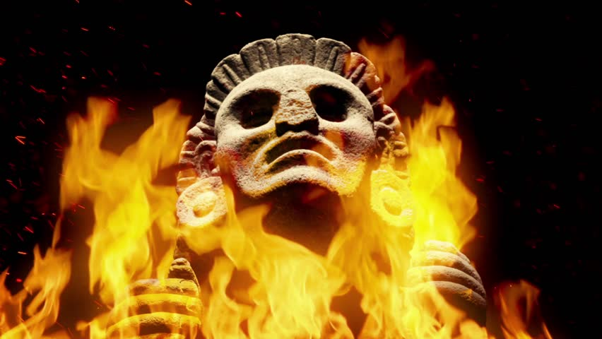Mayan Stone Figure In Flames