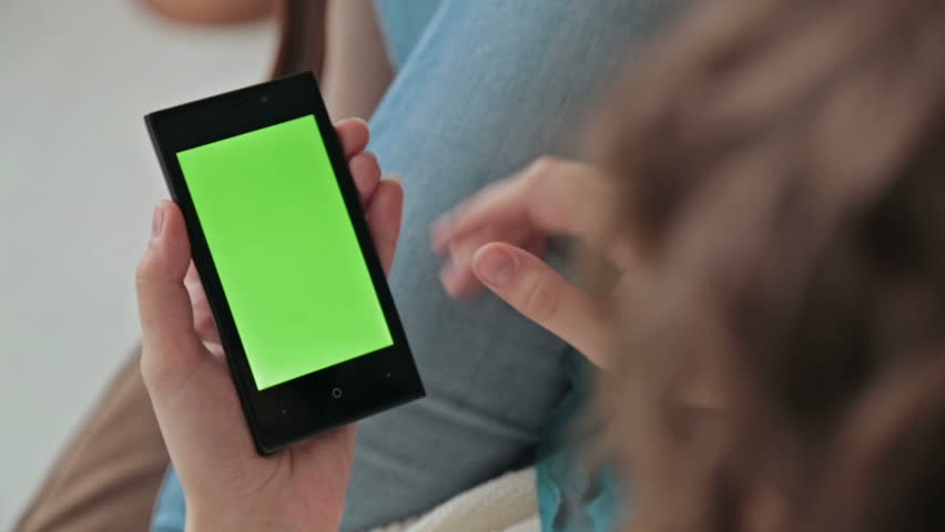Woman using a mobile phone with green screen and scrolling | Shutterstock HD Video #16516210
