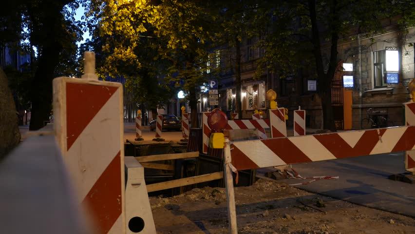 Blinking signs in a night city. Road repair. 4K UHD. | Shutterstock HD Video #16547236