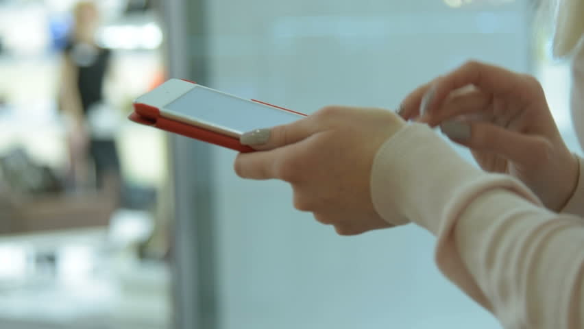 Close-up shot of a girl using tablet computer in the shopping centre | Shutterstock HD Video #16558546