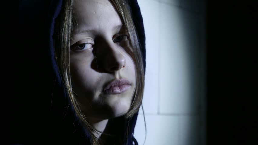 Teen girl. Drug addiction. Depressed face of a teen girl with overdose or hangover-abstinence syndrom from drugs. 4K UHD.