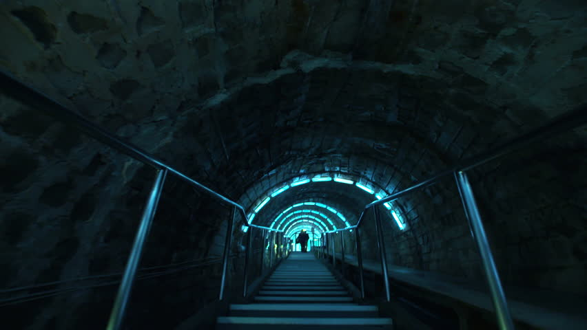 First person shooting walking on a Science fiction real tunnel #16563268