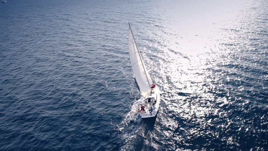 Yacht sailing on opened sea. Sailing boat. Yacht from drone. Yachting video. Yacht from above. Sailboat from drone. Sailing video. Yachting at windy day. Yacht. Sailboat. | Shutterstock Video #16596532