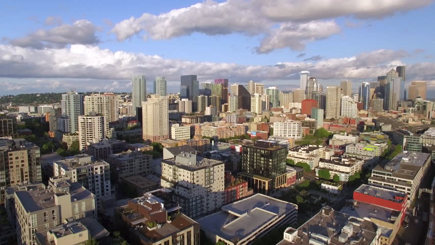 Aerial Pan of Amazing Cityscape with Downtown City Buildings with Blue Sky and Scattered Clouds | Shutterstock HD Video #16607785
