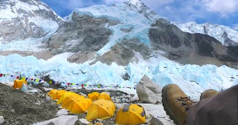 Feet of tourists in the background Everest base camp in the mountains of the Himalayas in Nepal at 5350m a.s.l the Khumbu camping.