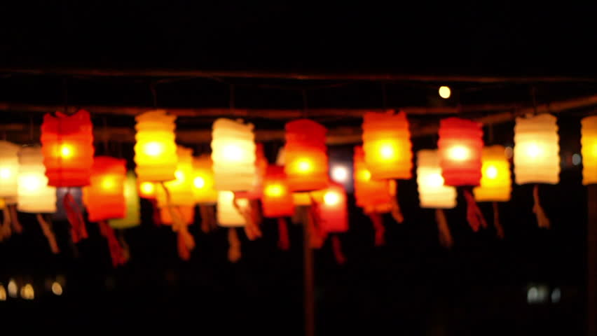 Thai style Lanna flag and Paper lanterns decorated by the river in Yee-peng festival ,ChiangMai Thailand