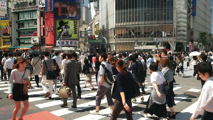 Tokyo- May 2016: People at Shibuya crossing. 4K resolution