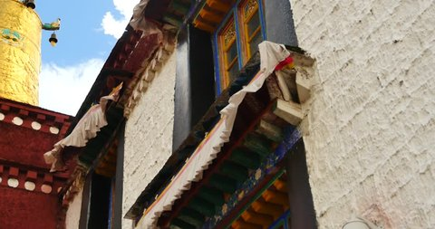4k closeup of The Jokhang Temple In Lhasa,Tibet,white clouds in blue sky. gh2_09673_4k