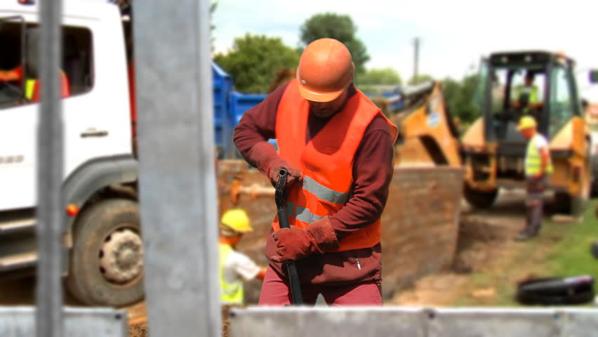 Back strain from overexertion during manual labor on a construction site.