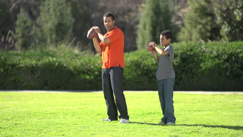 A father teaching his sons how to play American football. - Slow Motion - Model Released - 1920x1080 - Full HD - filmed at 59.94 fps | Shutterstock HD Video #16642846