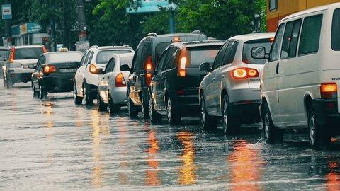Nikolaev, Ukraine - May 11, 2016: cars in a traffic jam in the rain, slow motion