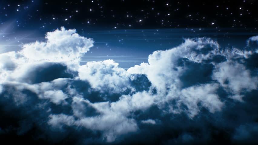 Night flight over clouds. Loop
