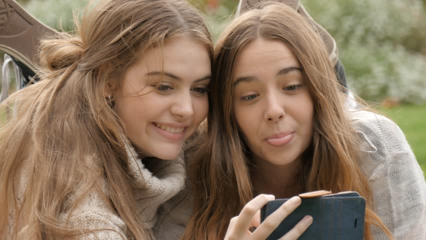 Happy Young Bff Gen Z Teen Girls On Mobile Phone Taking Selfie Photos Laughing