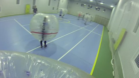 MOSCOW - SEP 23, 2015: (FPV) People play bumperball, New sport bumperball appeared in 2011 in Norway