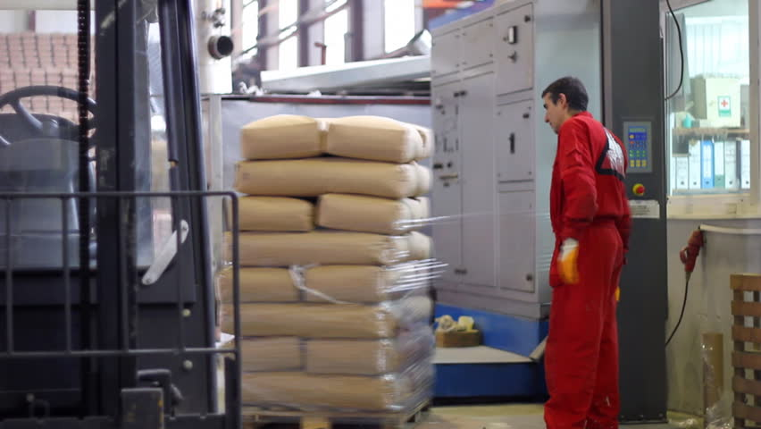 Worker packs bags of sugar