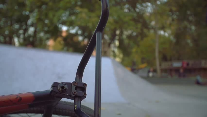 Close up of a bike lying on the pavement in a skate park on a sunny summer day. Close up slow motion shot. | Shutterstock HD Video #16810570