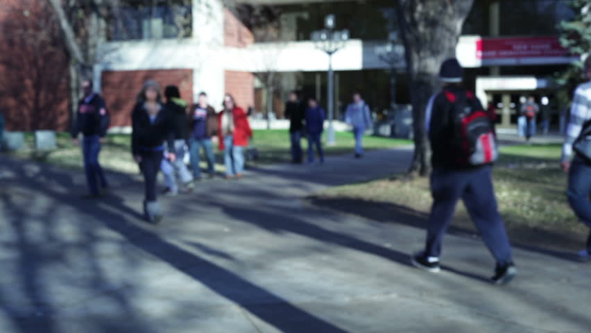 College students walking on a university campus.