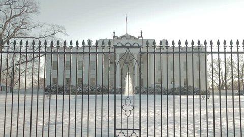 The White House behind an iron fence with fountain. Washington DC - USA: January, 2016