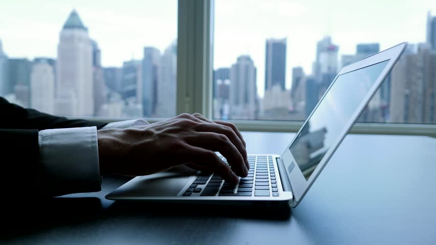 Working on laptop computer in modern office desk analyzing financial  profits progress. business charts diagrams background. online banking from home. city skyline window view  | Shutterstock HD Video #16830706