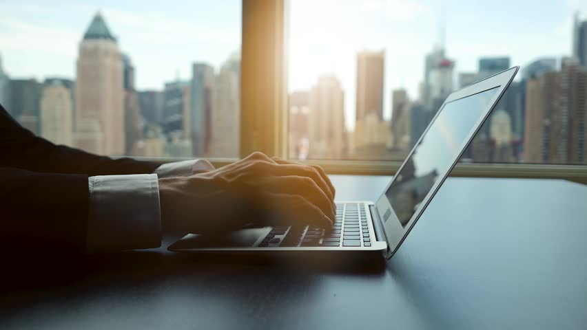 Working on laptop computer in modern office desk analyzing financial  profits progress. business charts diagrams background. online banking from home. city skyline window view  | Shutterstock HD Video #16830736
