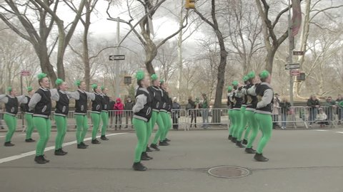 Girls in green dance in a line on St Patrick's Day. New York City, New York - USA: March, 2016