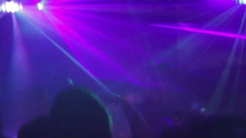 Intense scene of people dancing in Purple Nightclub setting. Sydney, Australia: July, 2015